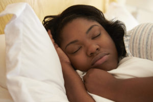 Overweight Woman Asleep In Bed